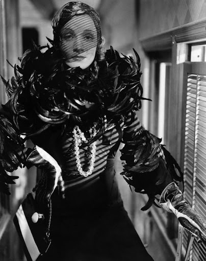 Dietrich's incarnation as the vampish Shanghai Express 1932, where Dietrich's Shanghai Lily is the embodiment of the stateless taxi-dancer a character redolent with dark Russian motifs.